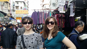 Anastasia and Dealia Lestina in Sunglasses at a Hong Kong street market